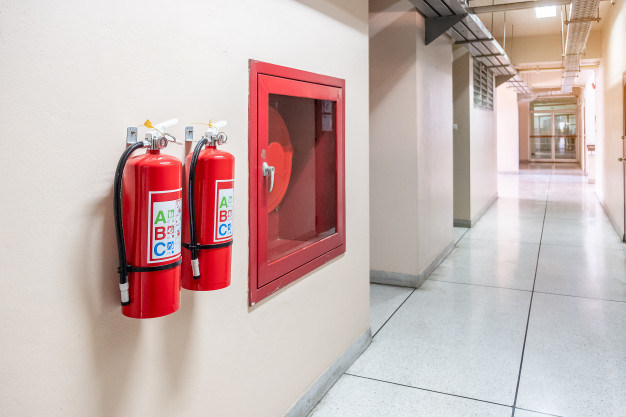 fire-extinguisher-system-wall-background-powerful-emergency-equipment-industrial_42256-1246